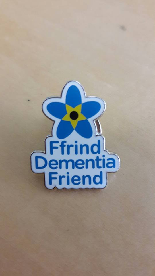 Proud to wear our Dementia Friend pin!