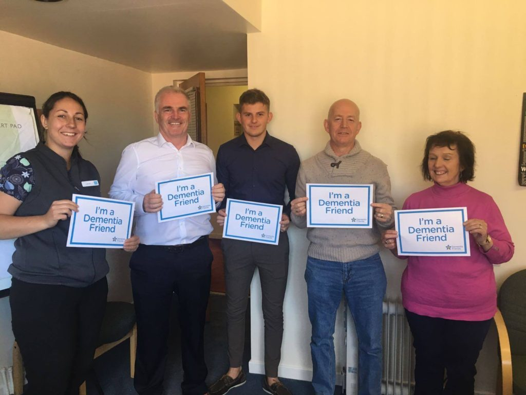 Laura from Abergele Co-op, Cllr Charlie McCoubrey, Ben from McCoubrey Cooke and Mr and Mrs Beattie becoming Dementia Friends!
