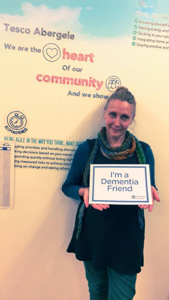 Clara Jones, from the Conwy Wellbeing team, showing off her new title as a Dementia Friend!